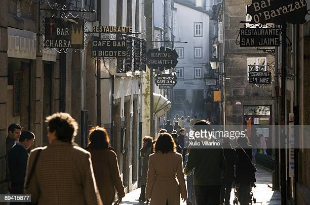 Santiago de Compostela. La Coruna. Galicia. Tourists walking for a typical street of the old city.