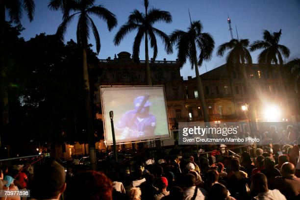 Santiago de Cuba fans watch their team play the Industriales of Havana in game number six of the finals of the Cuban baseball League on a screen in...