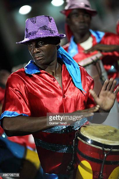 CONTENT] Santiago de Cuba July 25 2013 Members of the conga group Los Hoyos perform on the street The conga is the most widespread artistic...