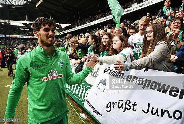 Santiago García of Bremen celebrates with fans after the Bundesliga match between Werder Bremen and VfL Wolfsburg at Weserstadion on April 16 2016 in...