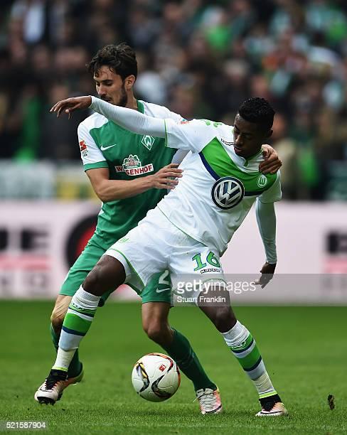 Santiago García of Bremen is challenged by Bruno Henrique of Wolfsburg during the Bundesliga match between Werder Bremen and VfL Wolfsburg at...