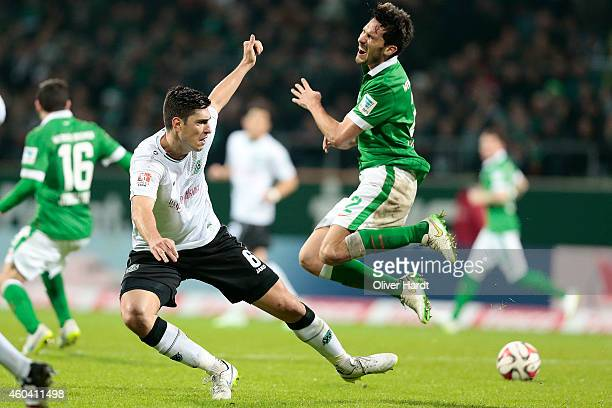 Santiago Garcia of Bremen and Ceyhun Guelselam of Hannover compete for the ball during the First Bundesliga match between SV Werder Bremen and...