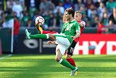 Santiago Garcia of Bremen and Jonathan Schmid of Freiburg battle for the ball during the Bundesliga match between SV Werder Bremen and SC Freiburg at...