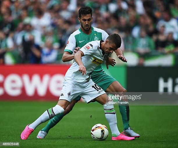 Santiago Garcia of Bremen is challenged by Thorgan Hazard of Gladbach during the Bundesliga match between Werder Bremen and Borussia Moenchengladbach...