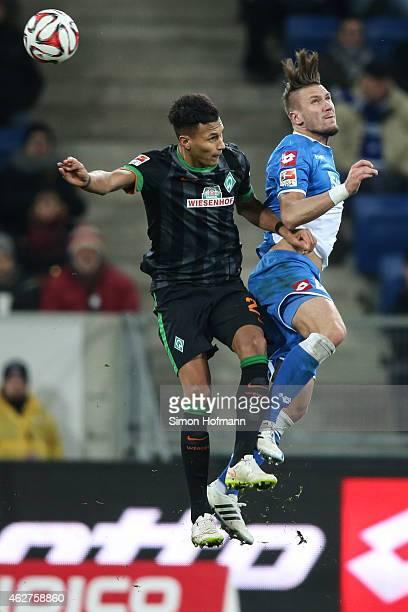 Santiago Garcia of Bremen jumps for a header with Ermin Bicakcic of Hoffenheim during the Bundesliga match between TSG 1899 Hoffenheim and SV Werder...