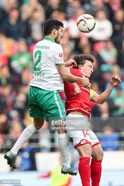 Santiago Garcia of Bremen jumps for a header with Julian Baumgartlinger of Mainz during the Bundesliga match between 1 FSV Mainz 05 and Werder Bremen...