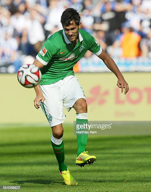 Santiago Garcia of Bremen runs with the ball during the Bundesliga match between Hertha BSC and SV Werder Bremen at Olympiastadion on August 23 2014...