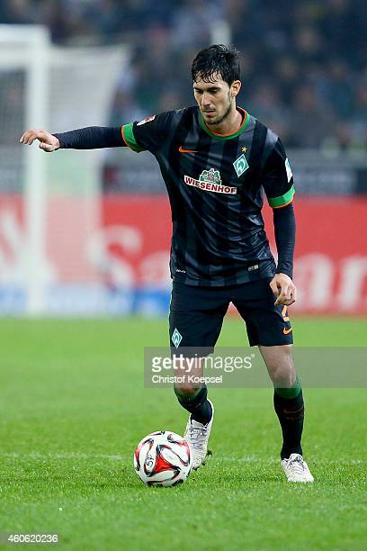 Santiago Garcia of Bremen runs with the ball during the Bundesliga match between Borussia Moenchengladbach and Werder Bremen at Borussia Park Stadium...