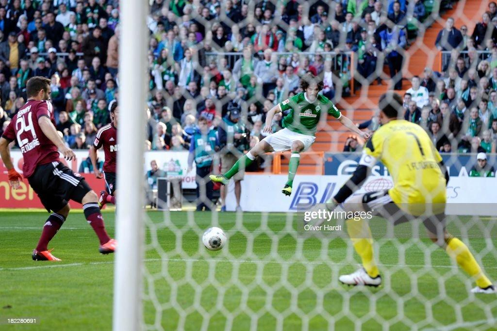 Santiago Garcia (C) of Bremen shot the first goal during the First Bundesliga match between SV Werder Bremen and 1.FC Nuernberg at Weserstadion on September 29, 2013 in Bremen, Germany.