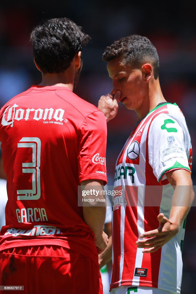 Santiago Garcia of Toluca touches the nose of Igor Lichnovsky of Necaxa during the fifth round match between Toluca and Necaxa as part of the Torneo Apertura 2017 Liga MX at Nemesio Diez Stadium on August 20, 2017 in Toluca, Mexico.