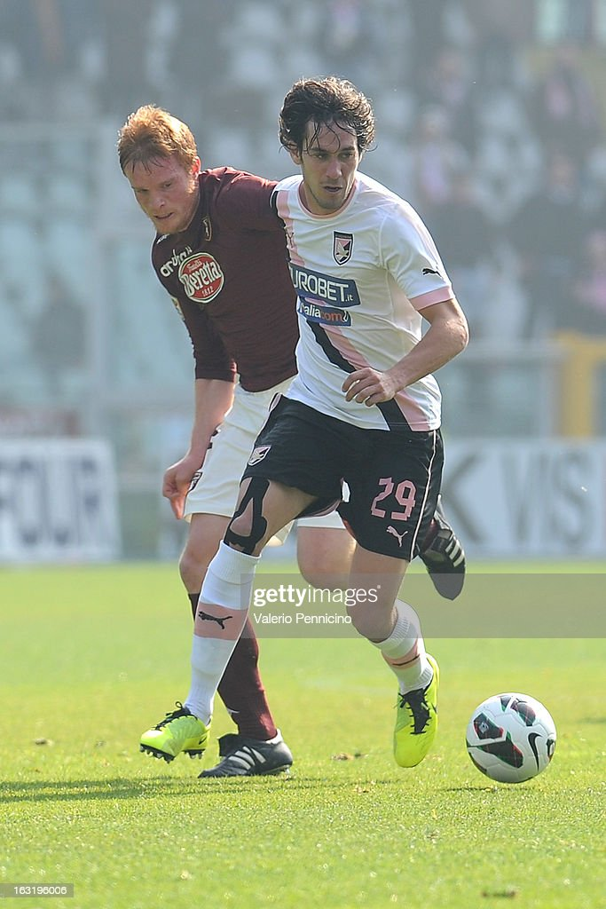 Santiago Garcia (R) of US Citta di Palermo in action against Alessandro Gazzi of Torino FC during the Serie A match between Torino FC and US Citta di Palermo at Stadio Olimpico di Torino on March 3, 2013 in Turin, Italy.