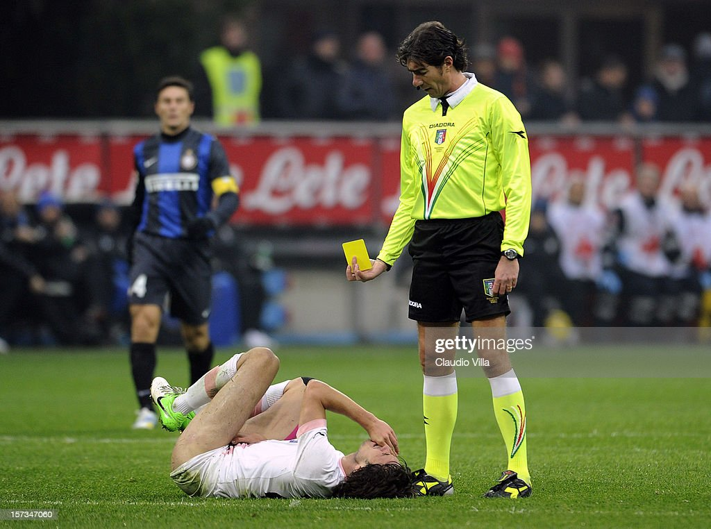 Santiago Garcia of US Citta di Palermo receives a yellow card from referee Mauro Bergonzi during the Serie A match between FC Internazionale Milano and US Citta di Palermo at San Siro Stadium on December 2, 2012 in Milan, Italy.