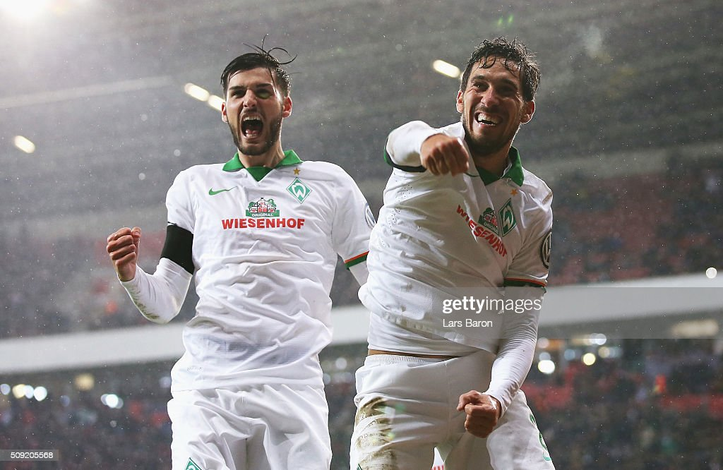 Santiago Garcia of Werder Bremen (R) celebrates after scoring their first and equalising goal during the DFB Cup Quarter Final match between Bayer Leverkusen and Werder Bremen at BayArena on February 9, 2016 in Leverkusen, Germany.