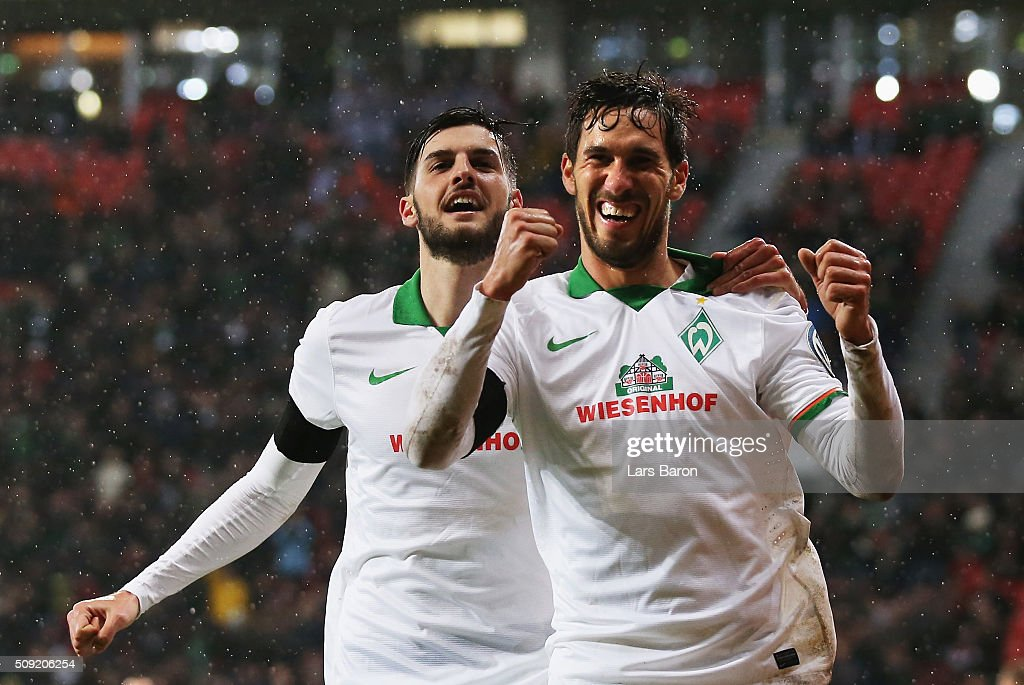 Santiago Garcia of Werder Bremen (R) celebrates with Florian Grillitsch after scoring their first and equalising goal during the DFB Cup Quarter Final match between Bayer Leverkusen and Werder Bremen at BayArena on February 9, 2016 in Leverkusen, Germany.