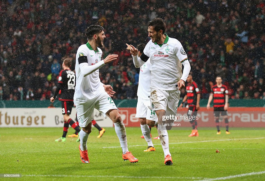 Santiago Garcia of Werder Bremen (R) celebrates with team mates scores their first and equalising goal during the DFB Cup Quarter Final match between Bayer Leverkusen and Werder Bremen at BayArena on February 9, 2016 in Leverkusen, Germany.