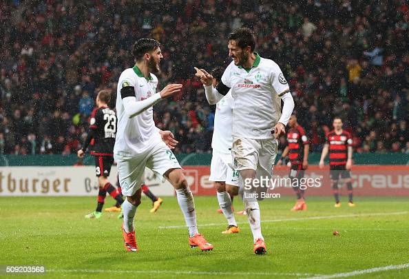Santiago Garcia of Werder Bremen celebrates with team mates scores their first and equalising goal during the DFB Cup Quarter Final match between...