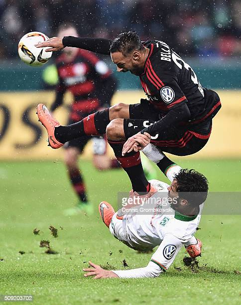 Santiago Garcia of Werder Bremen challenges Karim Bellarabi of Bayer Leverkusen during the DFB Cup Quarter Final match between Bayer Leverkusen and...