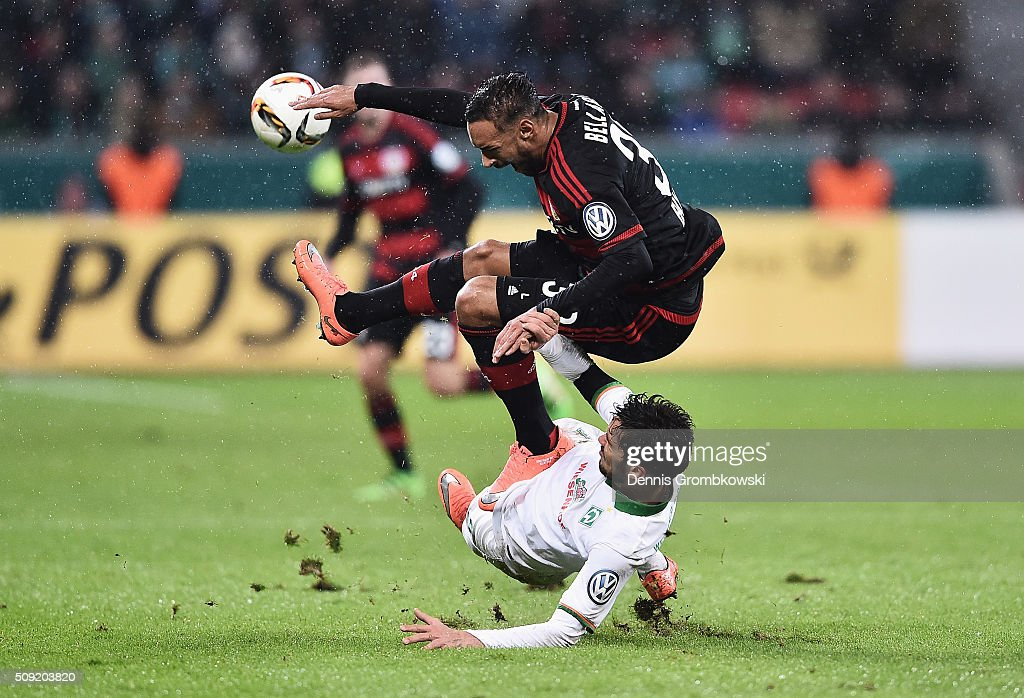 Santiago Garcia of Werder Bremen challenges <a gi-track='captionPersonalityLinkClicked' href=/galleries/search?phrase=Karim+Bellarabi&family=editorial&specificpeople=7158972 ng-click='$event.stopPropagation()'>Karim Bellarabi</a> of Bayer Leverkusen during the DFB Cup Quarter Final match between Bayer Leverkusen and Werder Bremen at BayArena on February 9, 2016 in Leverkusen, Germany.