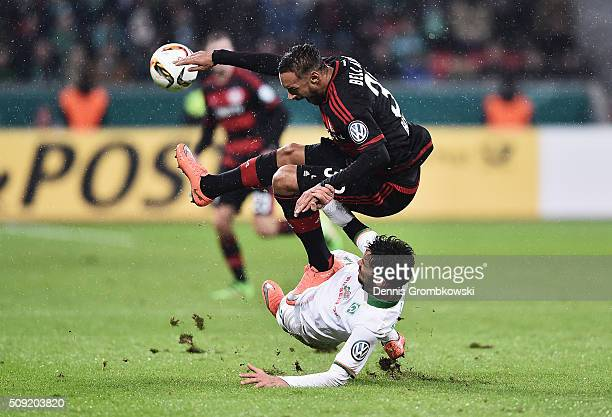 Santiago Garcia of Werder Bremen challenges Karim Bellarabi of Bayer Leverkusen during the DFB Cup Quarter Final match between Bayer Leverkusen and...