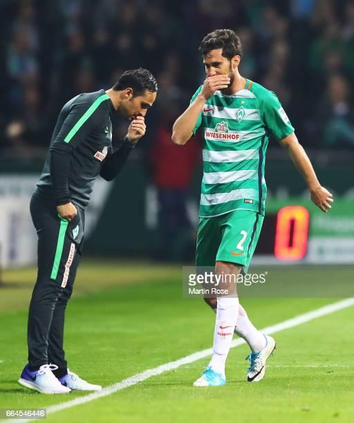 Santiago Garcia of Werder Bremen has a secret discussio with Alexander Nouri head coach of Werder Bremen during the Bundesliga match between Werder...