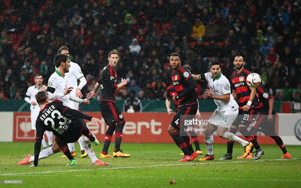 Santiago Garcia of Werder Bremen (2L) scores their first and equalising goal during the DFB Cup Quarter Final match between Bayer Leverkusen and Werder Bremen at BayArena on February 9, 2016 in Leverkusen, Germany.