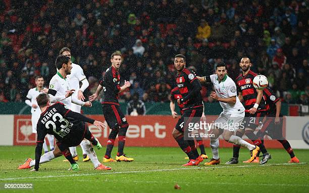Santiago Garcia of Werder Bremen scores their first and equalising goal during the DFB Cup Quarter Final match between Bayer Leverkusen and Werder...