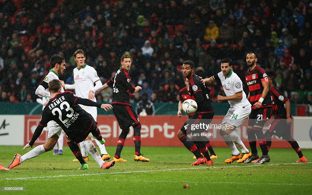Santiago Garcia of Werder Bremen (L) scores their first and equalising goal during the DFB Cup Quarter Final match between Bayer Leverkusen and Werder Bremen at BayArena on February 9, 2016 in Leverkusen, Germany.