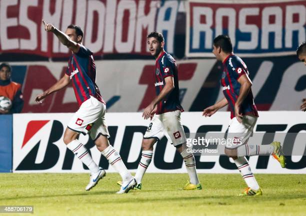Santiago Gentiletti of San Lorenzo and teammates celebrate their team's opening goal during a quarter final match between San Lorenzo and Cruzeiro as...