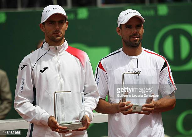 Santiago Giraldo and Alejandro Falla lpose for a picture after the match for the Final of the Seguros Bolivar Open Tournament at Club El Rancho on...