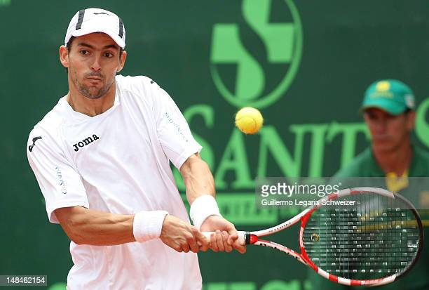 Santiago Giraldo hits the ball during a match against Alejandro Falla for the Final of the Seguros Bolivar Open Tournament at Club El Rancho on June...