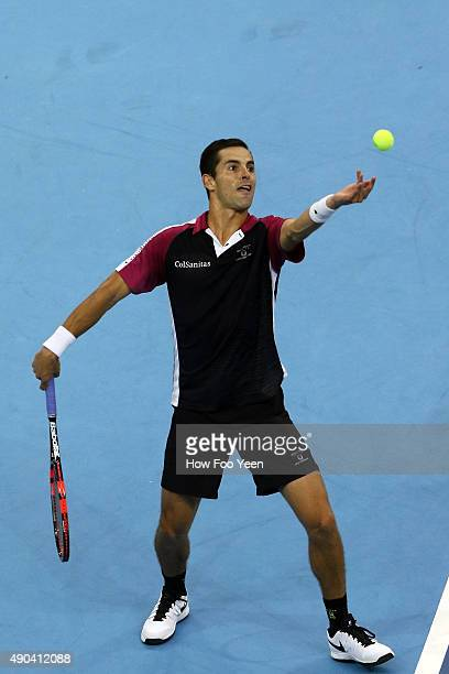 Santiago Giraldo of Colombia competes against Nick Kyrgios of Australia during the 2015 ATP Malaysian Open at Bukit Jalil National Stadium on...