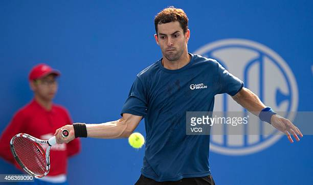 Santiago Giraldo of Colombia competes with John Isner of USA during day four of 2014 China Open at National Tennis Centre on September 30 2014 in...