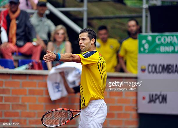Santiago Giraldo of Colombia gestures during the Davis Cup World Group Playoff singles match between Santiago Giraldo of Colombia and Kei Nishikori...