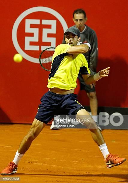 Santiago Giraldo of Colombia makes a shot during a tennis match between David Ferrer and Santiago Giraldo as part of ATP Buenos Aires Copa Claro on...