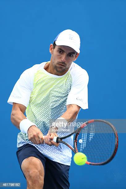 Santiago Giraldo of Colombia plays a backhand in his first round match against Jan Hernych of the Czech Republic during day two of the 2015...