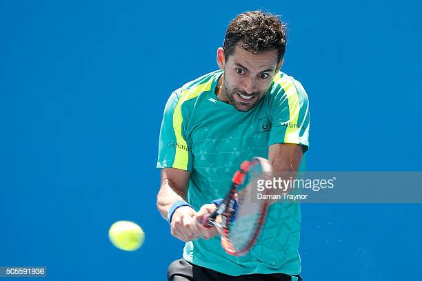 Santiago Giraldo of Colombia plays a backhand in his first round match against Donald Young of the United States during day two of the 2016...