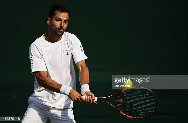 Santiago Giraldo of Colombia plays a backhand in his Gentlemen's Singles Third Round match against Denis Kudla of the United States during day five...