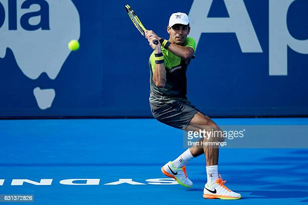 Santiago Giraldo of Colombia plays a backhand shot in his first round match against Marcel Granollers of Spain during day three of the 2017 Sydney...