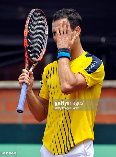 Santiago Giraldo of Colombia reacts during the Davis Cup World Group Playoff singles match between Santiago Giraldo of Colombia and Kei Nishikori of...