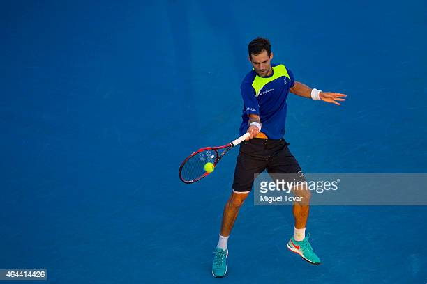 Santiago Giraldo of Colombia returns a shot during a men's singles match against Viktor Troicki of Serbia as part of Telcel Mexican Open 2015 at...