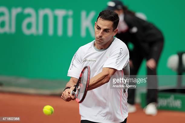 Santiago Giraldo of Colombia returns the ball to Diego Schwartzman of Argentina during men's single tennis match at Garanti Koza Arena during the TEB...