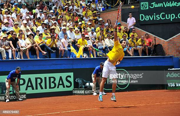 Santiago Giraldo of Colombia serves a ball during the Davis Cup World Group Playoff singles match between Santiago Giraldo of Colombia and Kei...
