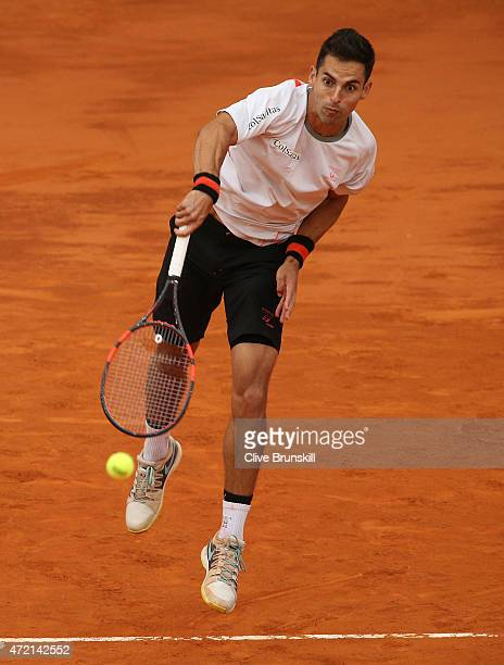 Santiago Giraldo of Colombia serves against Fabio Fognini of Italy in their first round match during day three of the Mutua Madrid Open tennis...
