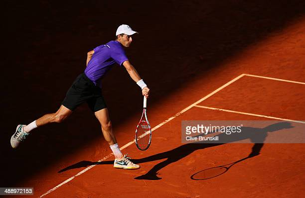 Santiago Giraldo of Colombia serves against Roberto Bautista Agut of Spain in their quarter final match during day seven of the Mutua Madrid Open...