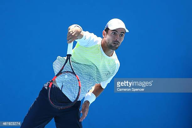 Santiago Giraldo of Colombia serves in his second round match against Steve Johnson of the United States during day four of the 2015 Australian Open...