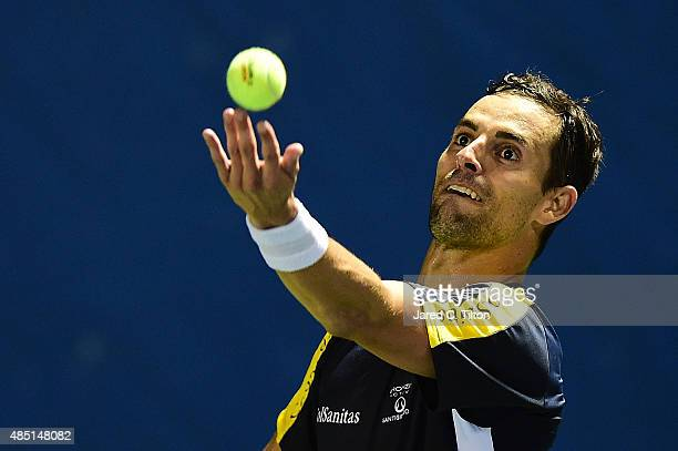 Santiago Giraldo of Colombia serves to Borna Coric of Croatia during the first day of the WinstonSalem Open at Wake Forest University on August 24...