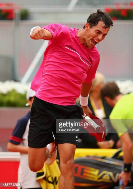 Santiago Giraldo of Columbia celebrates after his straight sets victory against Andy Murray of Great Britain in their third round match during day...