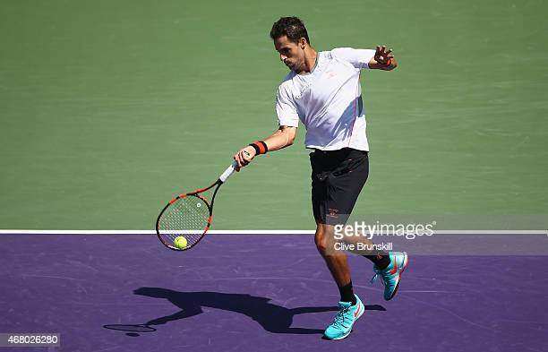 Santiago Giraldo of Columbia plays a forehand against Andy Murray of Great Britain in their third round match during the Miami Open Presented by Itau...