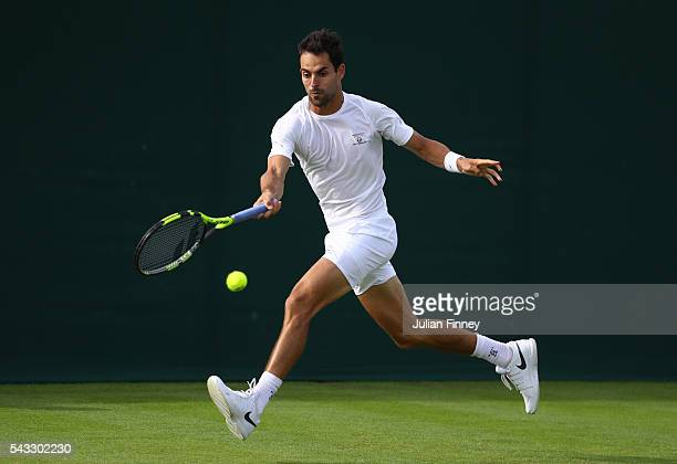 Santiago Giraldo of Columbia plays a forehand shot during the Men's Singles first round match against Gilles Muller of Luxembourg on day one of the...
