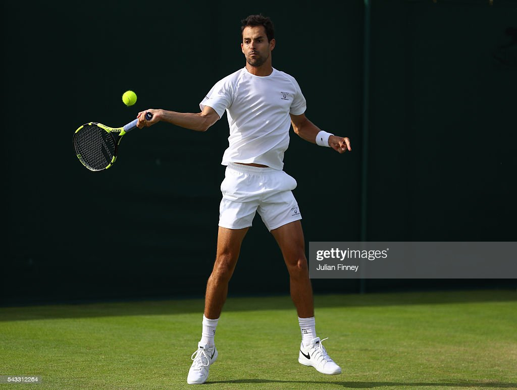 <a gi-track='captionPersonalityLinkClicked' href=/galleries/search?phrase=Santiago+Giraldo&family=editorial&specificpeople=698861 ng-click='$event.stopPropagation()'>Santiago Giraldo</a> of Columbia plays a forehand shot during the Men's Singles first round against Giles Muller on day one of the Wimbledon Lawn Tennis Championships at the All England Lawn Tennis and Croquet Club on June 27th, 2016 in London, England.